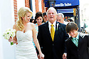 Trina Grimes Scott and former Louisiana Governor Edwin Edwards and guests walk down Bourbon Street after a wedding ceremony in the French Quarter in New Orleans, La., Friday, July 29, 2011. Edwards was recently released from prison where he served eight years on corruption charges....(AP Photo/Cheryl Gerber)