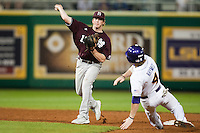 Mississippi State Bulldog second baseman Matt Britton #15 turns a doubel play against the LSU Tigers during the NCAA baseball game on March 16, 2012 at Alex Box Stadium in Baton Rouge, Louisiana. LSU defeated Mississippi State 3-2 in 10 innings. (Andrew Woolley / Four Seam Images)