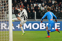 Calcio, semifinale di andata di Tim Cup: Juventus vs Napoli. Torino, Juventus Stadium, 28 febbraio 2017.<br /> Juventus' Gonzalo Higuain, left, kicks to score past Napoli's Ivan Strinic during the Italian Cup semifinal first leg football match between Juventus and Napoli at Turin's Juventus stadium, 28 February 2017.<br /> UPDATE IMAGES PRESS/Manuela Viganti