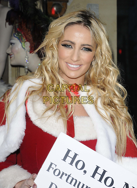 Chantelle Houghton.The PETA photocall to protest against the store Fortnum & Mason's continued sale of Foie Gras, Fortnum & Mason, Piccadilly, London, England..December 22nd, 2011.half length red white fur dress cape  trim santa claus  .CAP/CAN.©Can Nguyen/Capital Pictures.