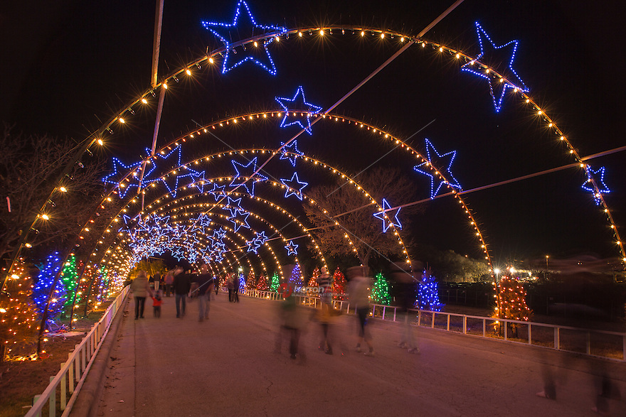 Visitors walk through the Zilker Park Trail of Lights Starry Night ...