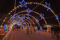 Visitors walk through the Zilker Park Trail of Lights Starry Night Tunnel