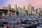 Vancouver area of Burrard bridge showing apartment, office blocks marina and Burrard bridge at dusk. British Columbia, Canada