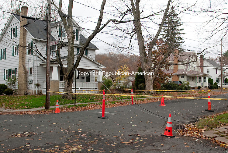NAUGATUCK, CT-30 October 2012-103012BF11--  Power lines brought down by Hurricane Sandy lay across Beardsley Avenue in Naugatuck. The remnants of Hurricane Sandy are still being felt across Connecticut Tuesday as the cleanup begins.  Bob Falcetti Republican-American