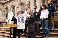 U.S. Soccer president Sunil Gulati (right) presents deputy mayor for government affairs and communications Howard Wolfson with a US Soccer Jersey  at a press conference honoring the centennial of U. S. Soccer at City Hall in New York, NY, on April 05, 2013.