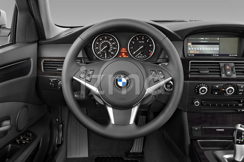 Steering wheel view of a 2009 BMW 5 Series 528