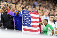 Houston, TX - Thursday July 20, 2017: Fan holding the American flag during the National Anthem during a match between Manchester United and Manchester City in the 2017 International Champions Cup at NRG Stadium.