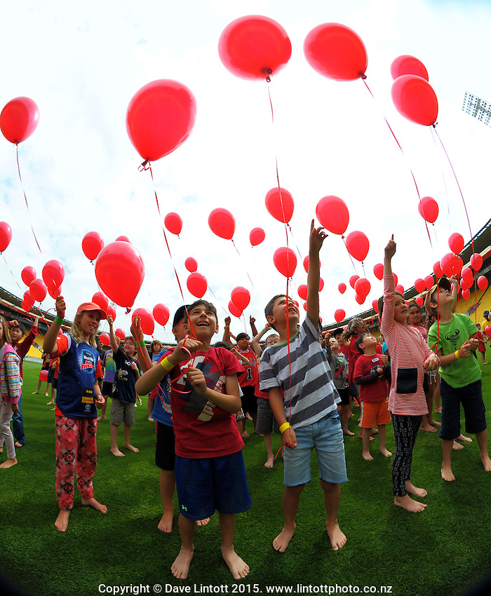 Kids wait to release 100 balloons at the AFL celebration of 100 day countdown until the ANZAC Centenary at Westpac Stadium, Wellington, New Zealand on Wednesday, 15 January 2015. Photo: Dave Lintott / lintottphoto.co.nz