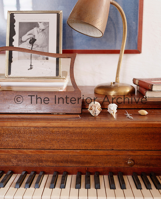 An eclectic collection of 'things' is displayed on the piano case in the dining room