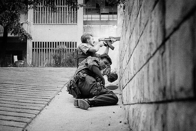 Mostar, Bosnia, 1993.<br /> <br /> Bosnian Croat police in firefight with Bosnian Muslims, frontline, Mostar.