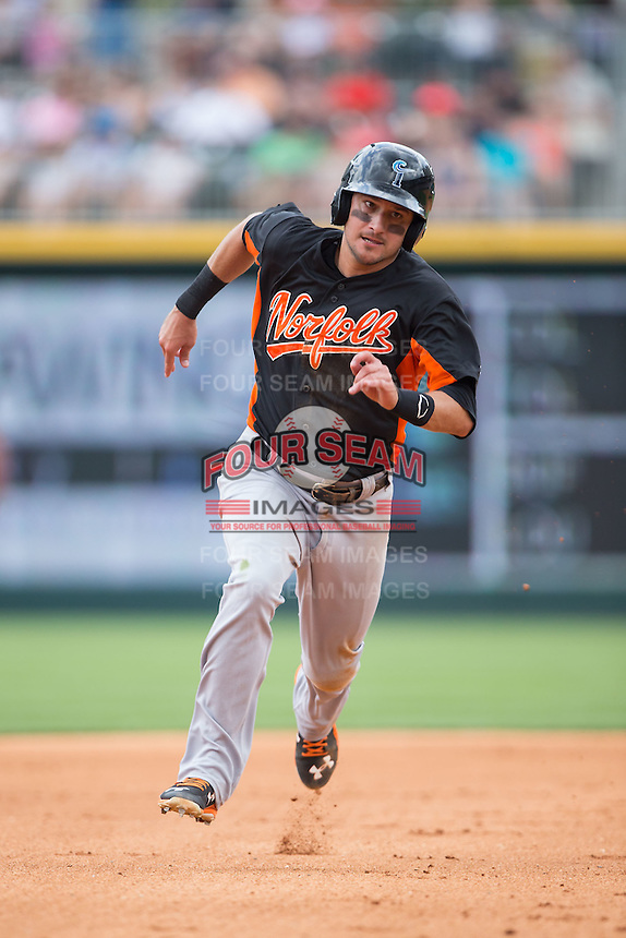 Paul Janish (11) of the Norfolk Tides hustles towards third base against the Charlotte Knights at BB&T BallPark on June 7, 2015 in Charlotte, North Carolina.  The Tides defeated the Knights 4-1.  (Brian Westerholt/Four Seam Images)