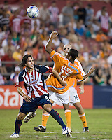 CD Guadalajara forward Omar Arellano (9) attempts to hold Houston Dynamo midfielder Ricardo Clark (13) off the ball.  CD Guadalajara defeated Houston Dynamo 1-0 during the group stage of the Superliga 2008 tournament at Robertson Stadium in Houston, TX on July 15, 2008.