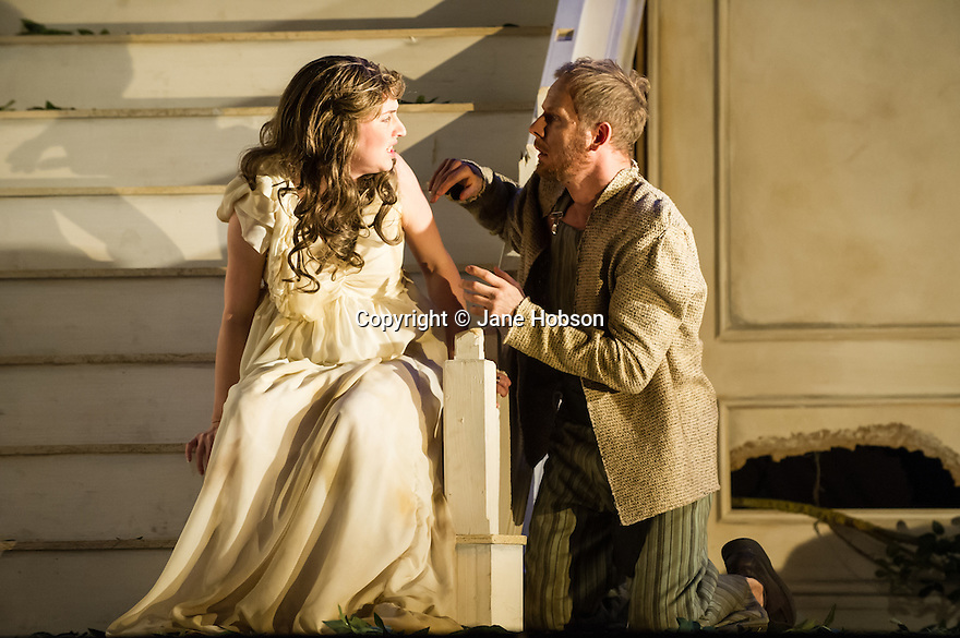 London, UK. 02.10.2013. English Touring Opera present JASON, by Francesco Cavalli, in the Britten Theatre, at the Royal College of Music. Picture shows: Catrine Kirkman (Isiphile) and Piotr Lempa (Orestes). Photograph © Jane Hobson.