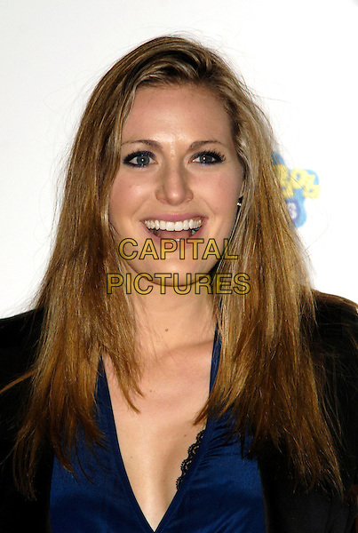 OLIVIA LEE .Attending the charity auction of SpongeBob SquarePants Artwork, London, England, UK, .21st January 2010..portrait headshot blue mouth open lace cleavage low cut v-neck .CAP/CJ.©Chris Joseph/Capital Pictures.