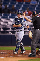 Lakeland Flying Tigers catcher Kade Scivicque (28) questions a call with umpire Reid Joyner during a game against the Tampa Yankees on April 8, 2016 at George M. Steinbrenner Field in Tampa, Florida.  Tampa defeated Lakeland 7-1.  (Mike Janes/Four Seam Images)