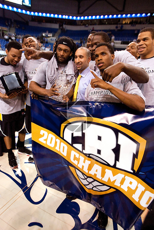 March 31,  2010                               Members of the Virginia Commonwealth University team stand behind a banner proclaiming them the champions of the CBI Tournament.  They defeated Saint Louis University 71-65 for the victory in the second game, in the best-of-three series championship.  The game was played at SLU's Chaifetz Arena, near downtown St. Louis on Wednesday March 31, 2010.
