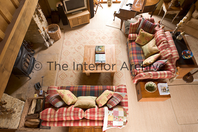 A view of the double-height living area looking down from the gallery