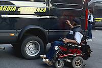 Roma, 19 Ottobre 2013<br /> Corteo contro l'austerità e la precarietà<br /> L'assedio al Ministero dell'economia in via XX Settembre.Un uomo in sedia a rotella disegna una A cerchiata sul blindato della Finanza
