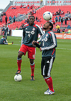 14 April 2012: Toronto FC midfielder Julian de Guzman #6 shows his ball skills as Toronto FC defender Doneil Henry #4 looks on during the warm-up in a game between Chivas USA and Toronto FC at BMO Field in Toronto..Chivas USA won 1-0.