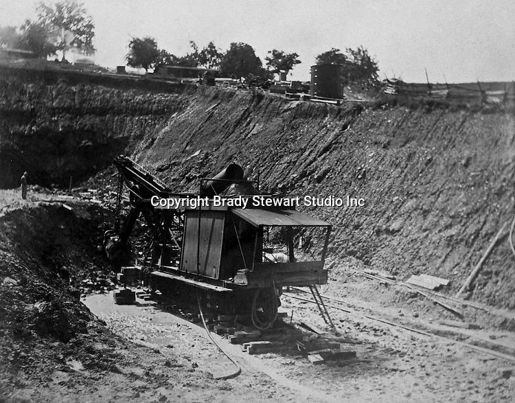Client:  Wabash Railroad<br /> Product: Barnhart's Railroad Ditcher<br /> Manufacturer: Marion Power Steam Shovel Company<br /> <br /> Hopedale OH:  West approach to the Spellacy Tunnel - 1903.  View of railroad steam shovel clearing the entrance of the tunnel.  The Pittsburgh, Toledo and Western Railroad company, owned by the famous George J. Gould,  hired Brady Stewart to document the track and tunnel construction between Hopedale Ohio and downtown Pittsburgh.