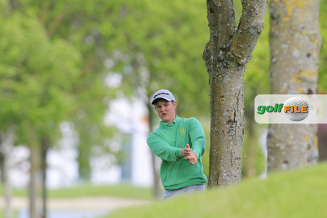 John Ross Galbraith (AM)(IRL) prepares to play his 2nd shot from the trees on the 11th hole during Thursday's Round 1 of the 2016 Dubai Duty Free Irish Open hosted by Rory Foundation held at the K Club, Straffan, Co.Kildare, Ireland. 19th May 2016.<br /> Picture: Eoin Clarke | Golffile<br /> <br /> <br /> All photos usage must carry mandatory copyright credit (&copy; Golffile | Eoin Clarke)