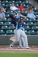Eddy Martinez (51) of the Myrtle Beach Pelicans follows through on his swing against the Winston-Salem Dash at BB&T Ballpark on May 11, 2017 in Winston-Salem, North Carolina.  The Pelicans defeated the Dash 9-7.  (Brian Westerholt/Four Seam Images)