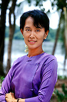 Aung San Suu Kyi, Democratic leader of Burma, political prisoner &amp; 1991 Nobel Peace Prize recipient, Yangon, Burma/Myanmar 1996.<br /> Although the politics of Burma have stabilized somewhat in recent years, the Burmese military refused to recognize the elections won by Aung San Suu Kyi and her National League for Democracy (NLD) in 1990, instead seizing all power and placing her under house arrest for 15 years. While still imprisoned, she was awarded the Nobel Peace Prize in 1991 and was cited by the Nobel Committee as one of the most extraordinary examples of civil courage in Asia in recent decades. <br /> I was able to meet Aung San Suu Kyi shortly after she was initially freed from house arrest for a short period and was deeply impressed by her dignity and inner strength during her ongoing struggle for democracy. This day was the first time in six years she had been able to leave her house for the New Year and the NLD members swarmed her front lawn in joyous celebration.