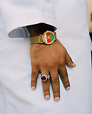 OMAN, Muscat, man wearing wristwatch and finger ring, Omani flag designed on watch dial