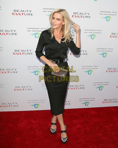 JENNY McCARTHY .at The opening of Beauty Culture - a photographic exploration of how feminine beauty is defined, challenged and revered in modern society held at Annenberg Space for Photography in Century City, California, USA,  .May 19th 11..full length skirt pencil hand touching hair clutch bag shoes  black shirt belt                                            .CAP/RKE/DVS.©DVS/RockinExposures/Capital Pictures.