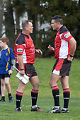 Referee Antony Petrie consults Assistant Referee Simon Long regarding the grounding of the 82nd minute try to Patumahoe.  Counties Manukau Premier Club Rugby Semi-final game between Patumahoe and Manurewa, played at Patumahoe on Saturday July 14th 2018. Patumahoe won the game 29 - 28 after trailing 7 - 14 at halftime. <br /> Photo by Richard Spranger.