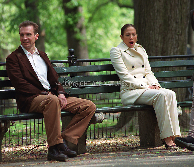 "Jennifer Lopez and Ralph Fiennes filming ""The Chambermaid"" directed by Wayne Wang in Central Park, New York. May 8, 2002. Please byline: Alecsey Boldeskul/NY Photo Press.   ..*PAY-PER-USE*      ....NY Photo Press:  ..phone (646) 267-6913;   ..e-mail: info@nyphotopress.com"