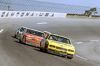 Dale Earnhardt (Chevrolet #3) leads Cale Yarborough (Oldsmobile #29) and Harry Gant (Chevrolet #33) through turn 4, Daytona 500, Daytona International Speedway, Daytona Beach, FL, February 1987.  (Photo by Brian Cleary/bcpix.com)