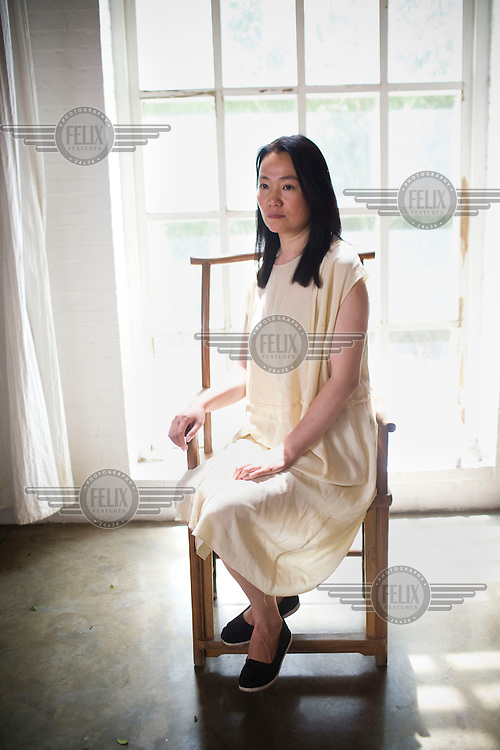 Lu Qing, artist Ai Weiwei's wife at Ai's studio in Beijing.