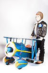 Retro child pilot with antique pedal plane
