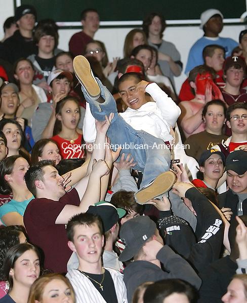 TORRINGTON, CT, 03/07/07- 030707BZ17-  Torrington freshman Renato Calderon crowd surfs during the game against Wilbur Cross<br /> in the second round Class LL tournament at Torrington High School Wednesday night.<br /> Jamison C. Bazinet Republican-American