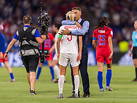 LYON,  - JULY 2: Phil Neville talks to Steph Houghton #5 during a game between England and USWNT at Stade de Lyon on July 2, 2019 in Lyon, France.