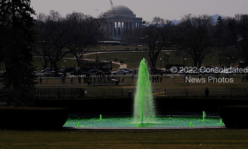 The White House Fountain is colored in green for the visit of  Prime Minister Enda Kenny of Ireland at the White House and to celebrate St Patrick's day in Washington, DC, March 17, 2011. .Credit: Olivier Douliery / Pool via CNP