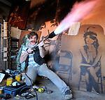 """Artist Walker Babington with his """"flamethrower""""."""