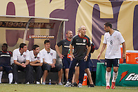 United States head coach Bob Bradley talks with midfielder Clint Dempsey (8). The men's national teams of the United States and Argentina played to a 0-0 tie during an international friendly at Giants Stadium in East Rutherford, NJ, on June 8, 2008.