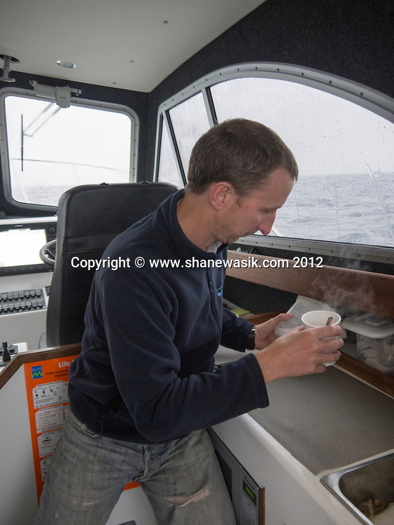 Skipper Ian Easingwood in marginal tea making conditions on the way home