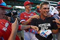 Nolan Gorman (9) of Sandra Day O'Connor High School in Glendale, Arizona is mobbed by teammates after winning the home run derby before the Under Armour All-American Game presented by Baseball Factory on July 29, 2017 at Wrigley Field in Chicago, Illinois.  Matthew Liberatore is behind Gorman.  (Mike Janes/Four Seam Images)