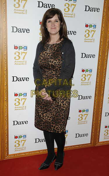 SIOBHAN FINNERAN .The Broadcasting Press Guild TV & Radio Awards, Theatre Royal, Drury Lane, London, England..March 25th, 2011.full length black cardigan brown leopard print dress tights.CAP/CAN.©Can Nguyen/Capital Pictures.