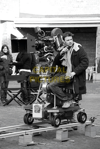 Francois Ozon (Director).on the set of Potiche (2010) .*Filmstill - Editorial Use Only*.CAP/NFS.Supplied by Capital Pictures.