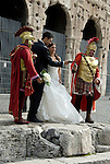 married couple photographed in rome, italy with roman knights