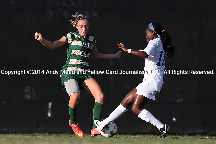 31 August 2014: UAB's Morgan Key-Adams (24) and Duke's Toni Payne (10). The Duke University Blue Devils hosted the University of Alabama Birmingham Blazers at Koskinen Stadium in Durham, North Carolina in a 2014 NCAA Division I Women's Soccer match. Duke won the game 3-1.