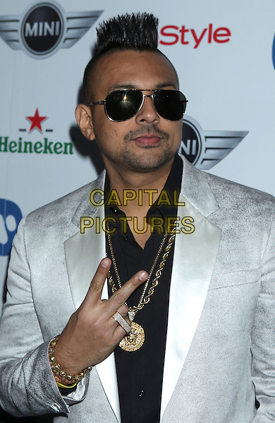 Sean Paul.Warner Music Group 2013 Grammy Celebration held at The Chateau Marmont, West Hollywood, California, USA..February 10th, 2013.half length black suit jacket gold necklaces silver grey gray suit jacket sunglasses shades stubble facial hair hand v peace sign rude gesture .CAP/ADM/RE.©Russ Elliot/AdMedia/Capital Pictures.