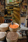 Shop selling pulses in the Sharia Souk in Luxor.The town of Luxor occupies the eastern part of a great city of antiquity which the ancient Egytians called Waset and the Greeks named Thebes.