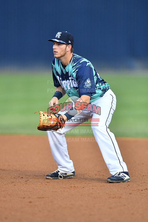 Asheville Tourists first baseman Grant Lavigne (34) during a game against the Greenville Drive on Hippie Night at McCormick Field on July 11, 2019 in Asheville, North Carolina. The Drive defeated the Tourists 6-2. (Tony Farlow/Four Seam Images)