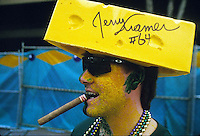 A Green Bay Packers fan in New Orleans shows off his freshly autographed cheesehead during Super Bowl week at the end of January, 1997.