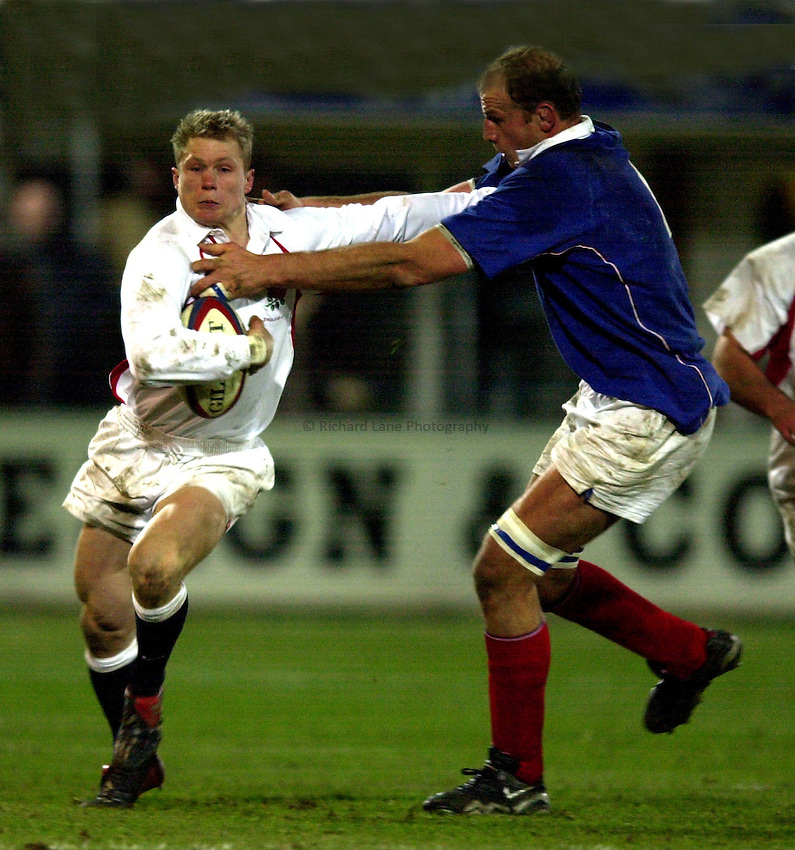 Photo. Richard Lane.England A v France A at Franklin Gardens, Northampton. 14/02/2003.Josh Lewsey is tackled by David Couzinet